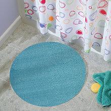Alfombra redonda azul claro sala de baño