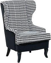 Beliani - Sillón tapizado negro/blanco MOLDE