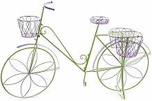 Bicicleta con soporte para macetas y flores para