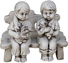 Figura Decorativa Niños en Banco de Piedra para