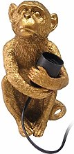 Lámpara de mesa mono de resina dorada de 15x11x21