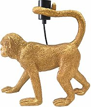 Lámpara de mesa mono de resina dorada de 39x13x37