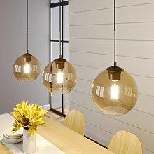 Lindby Sofian lámpara colgante, 3 luces, ámbar