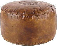 Puf marrón de piel caprina