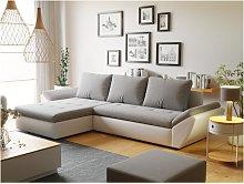 Sofá cama rinconera reversible de tela y piel