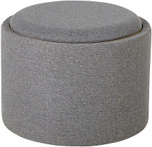 Taburete gris con superficie de color natural
